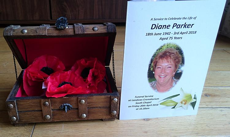 Paper poppies in a box and the service of remembrance card from Diane's funeral