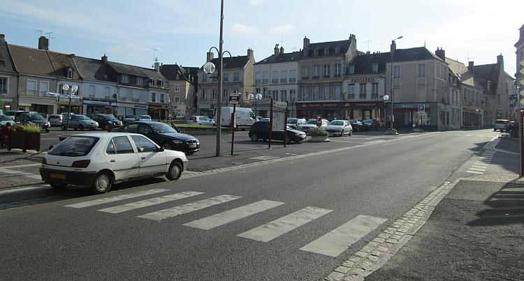 A french pedestrian crossing, just some white rectangles across the road