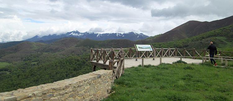 green hills and snow capped rock tipped mountains in the distance. Excellent Spanish scenery