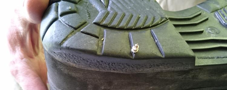 We can see the tip of the screws poking out through the bottom of the sole