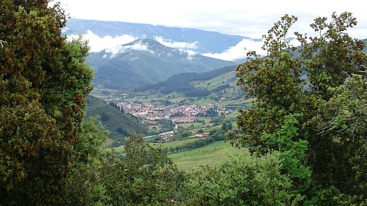 The town of Potes looks quite small in the foot of the valley between majestic verdant mountains