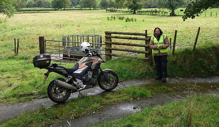 Ren stands by his CB500X on a country lane in South Wales