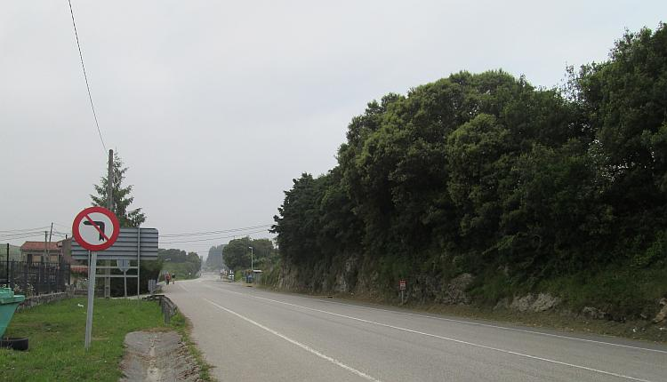 An ordinary and plain road with heavy thick grey skies in La Franca, Spain