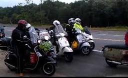 A motley collection of scooters on the road in Georgia