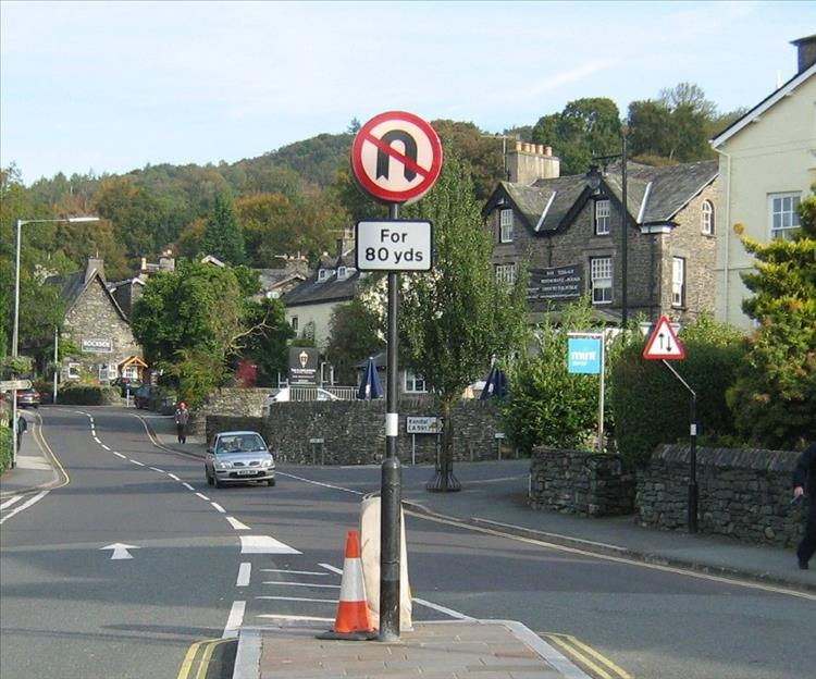 Just a few roads signs on a street in the lake District