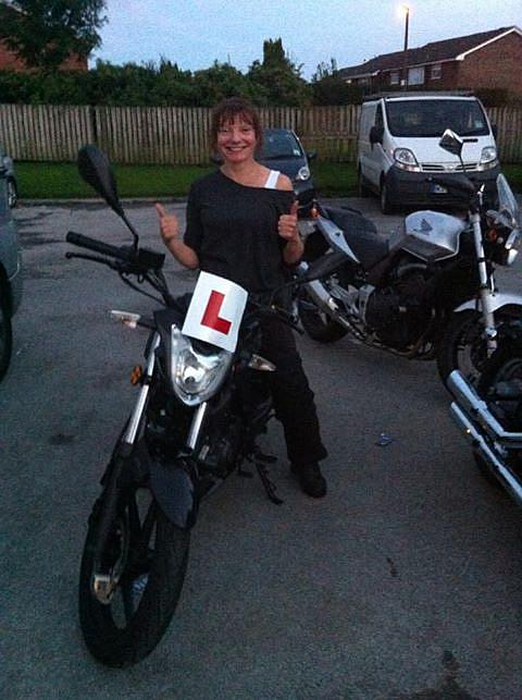 Sharon beaming with a big smile after passing her CBT
