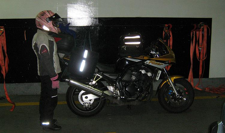 Sharon stands straight next to Ren's motorcycle on the Newhaven - Dieppe ferry