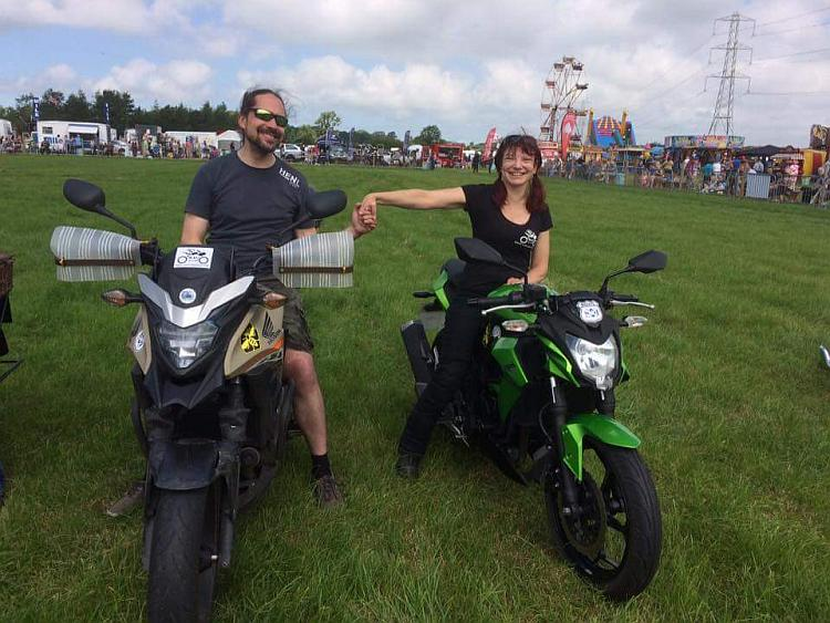 Sharon, Ren holding hands sat on their bikes at the Scorton Steam Fair