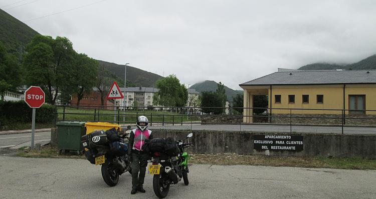 Sharon and the loaded bikes on a rather plain car park of a plain town heading north