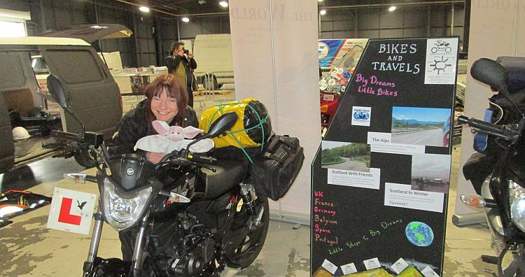 Sharon leans on her Keeway while setting up for the Manchester Bike Show in 2015