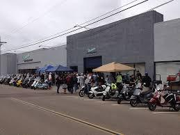 A small image of the scooters outside the Motorsport shop at the end of the ride