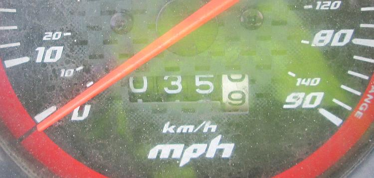 an old trip meter on a motorcycle