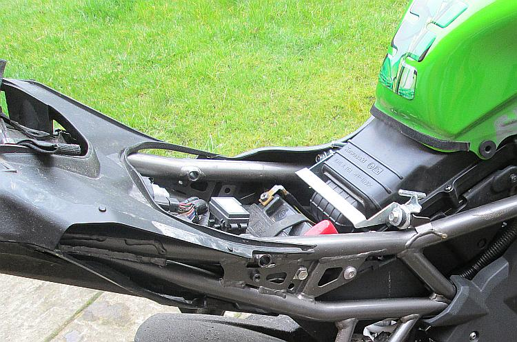 The battery can finally be accessed once the rider's seat is removed