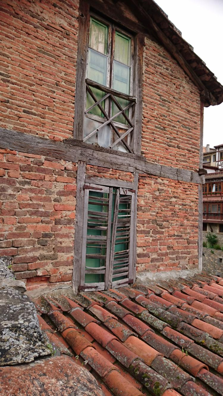 ancient thin bricks and terracotta clay roof tiles form the character of Potes