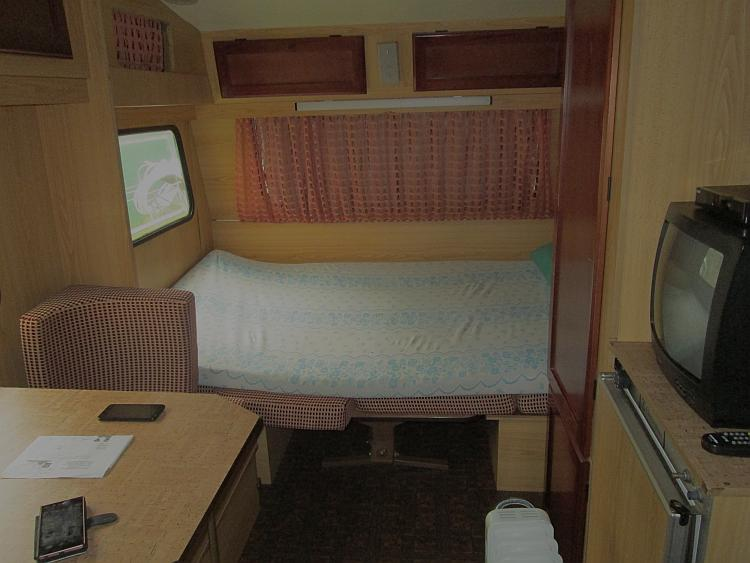 the inside of the small damp caravan