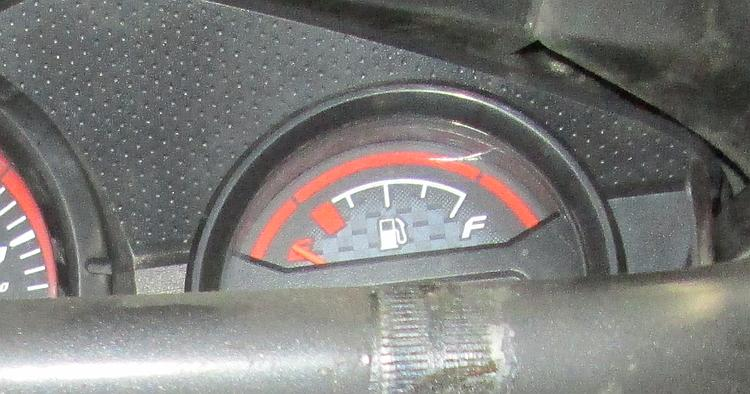 The fuel gauge on the CBF125 with the needle right at the bottom of the scale