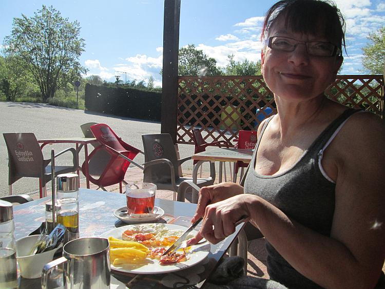Sharon smiles in the glorious sun as she devours he delicious breakfast