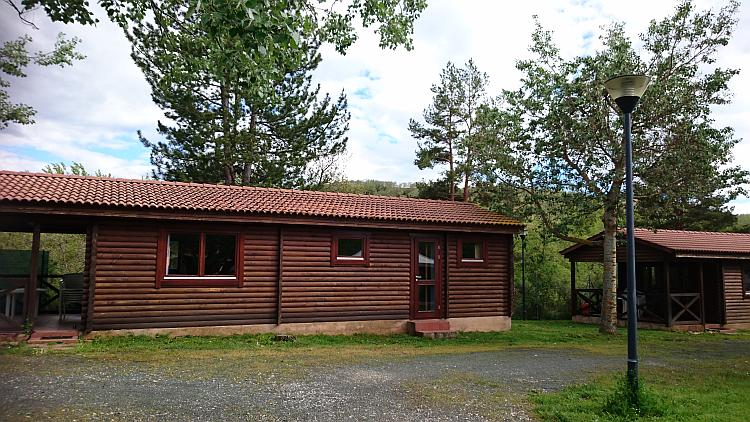 A wood log cabin or lodge at the campsite