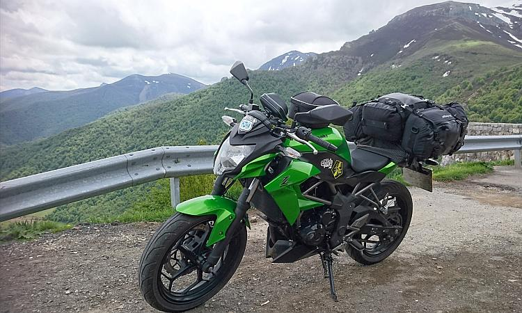 Sharons kawasaki z250sl with luggage against the stunning picos mountains