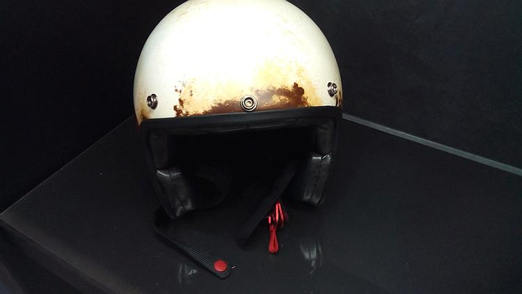 This open face helmet is painted to look like it's old, worn and dirty