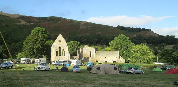 The ruins of a small abbey dominate the scene at the campsite near Llangollen