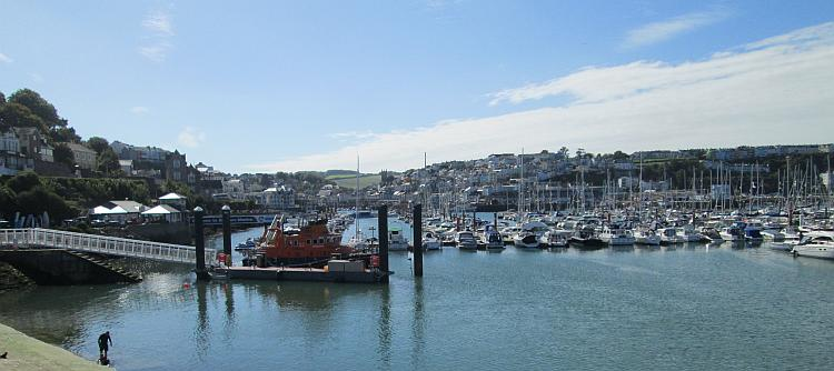 Brixham's harbour is large and filled with hundreds of boats, the town rises up from the bay