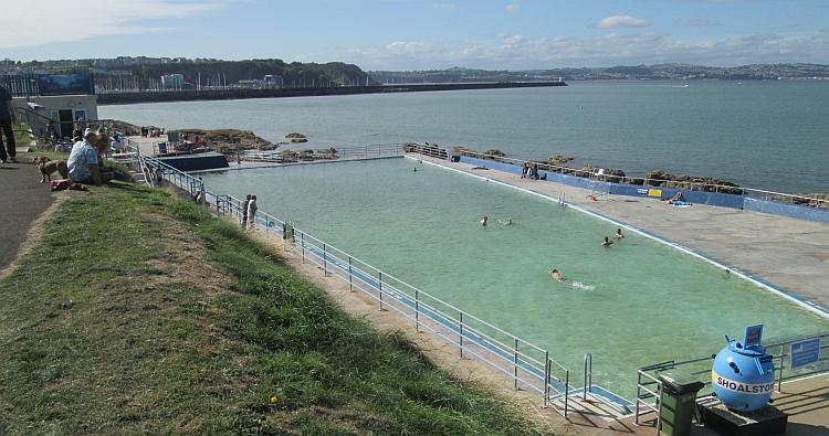 The turquiose waters of the Lido at Brixham look inviting on this warm day