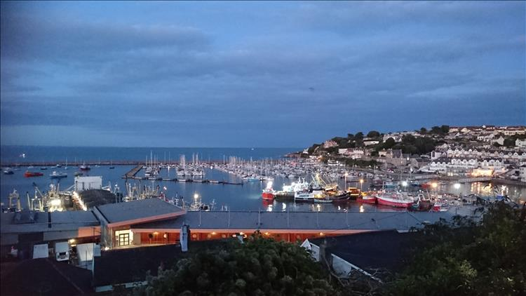 The lights on the harbour and the boats are starting to twinkle as the sun sets