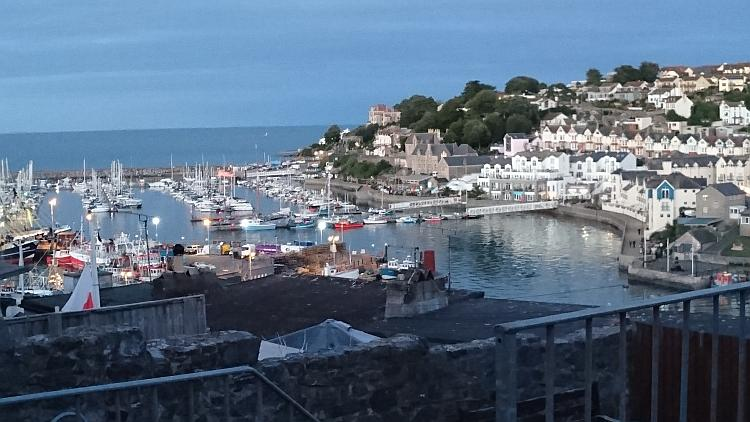 Looking down on Brixham Harbour we see boats, yachts, fishing boats and all manner of building