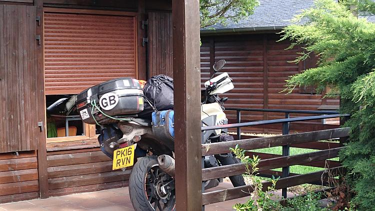 Ren's CB500X Honda on the veranda of the lodge