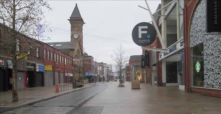 Fishergate Preston. A street filled with shops but no people because it's Christmas day