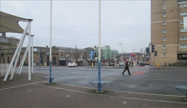 Southport is grey and devoid of life save for one person walking across the shot