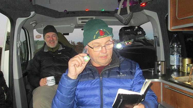 2 chaps are fooling around in the warmth of a small campervan