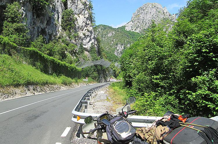 Steep rock faces, the road through the gorge and the nets to catch falling rocks