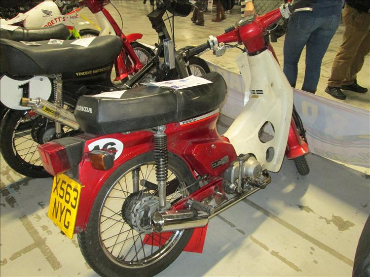 A Honda C90 at a motorcycle show in Manchester