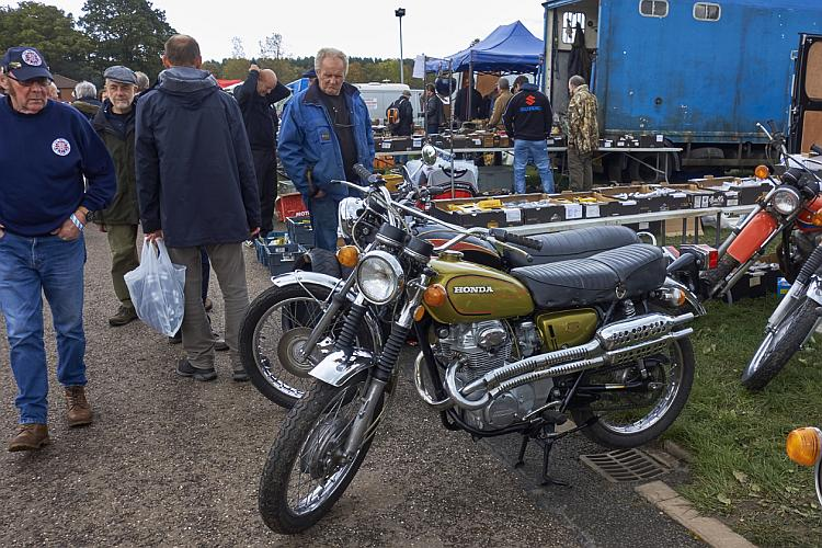 A Honda CB350 at the Classic Stafford show amidst lots of older men all milling around