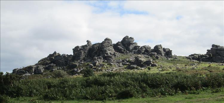 At the top of the hill is a large, angular, creviced and gnarly rocky outcrop