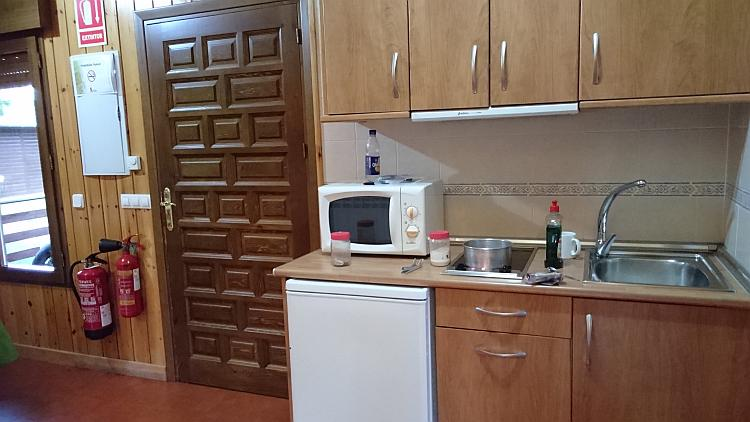 A small sink, microwave and cupbaords make the kitchen of the lodge