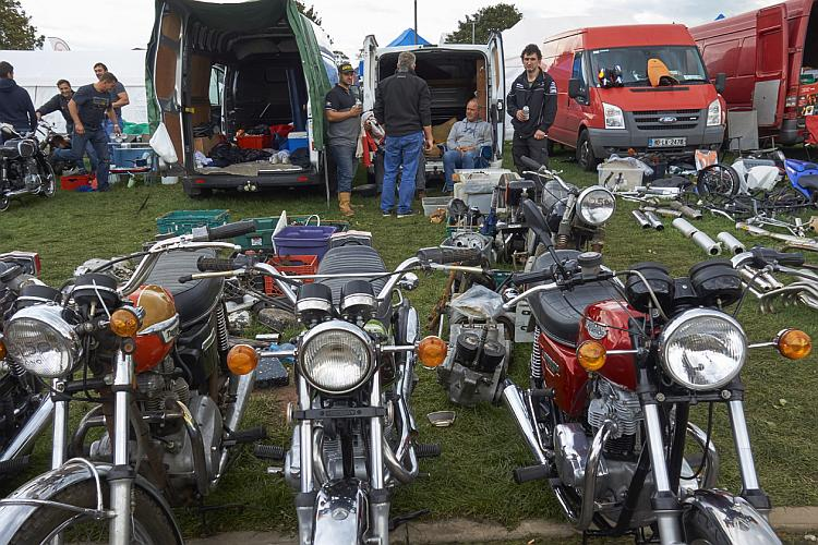 3 much smarter brit bikes for sale out the back of a van outside at the staffs show