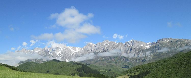 The rocky mountain peaks of The Picos De Europa in glorious sun and light cloud