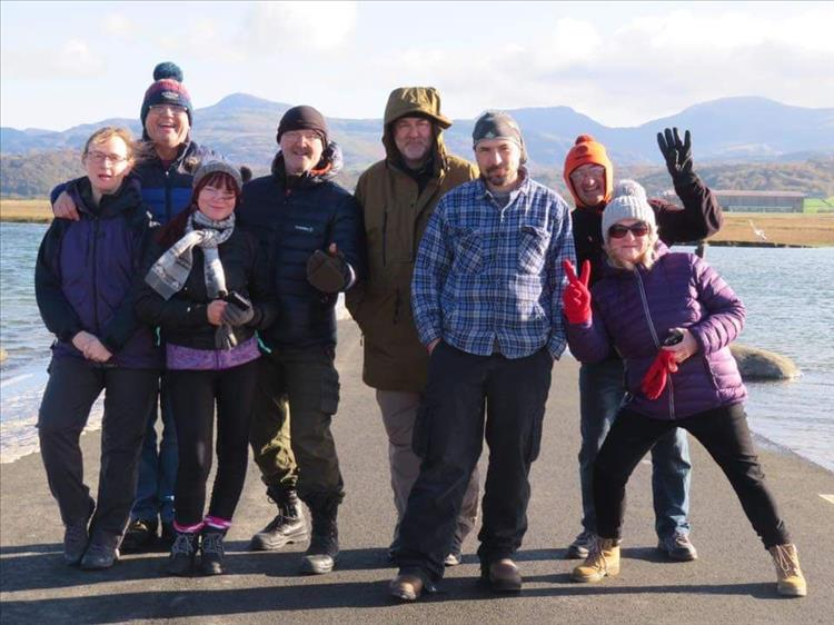 Sharon is surrounded by friends all smiling in the cold sun in Wales