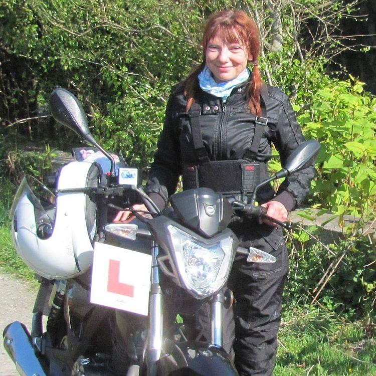 Sharon next to the 125 with L plates at the start of her two wheeled career