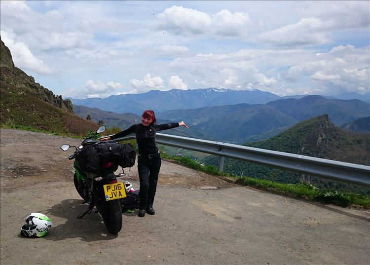 Sharon throws her arms open in joy at the amazing scenery of The Picos in Spain