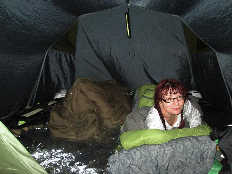 Sharon smiling at the camera in the tent in Santander Cabo De Mayor Camping