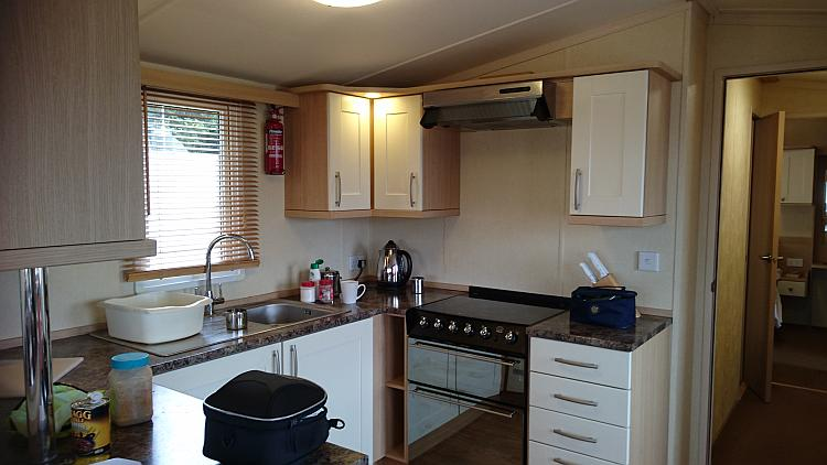 A clean and well provisioned kitchen within the static caravan that we are staying at