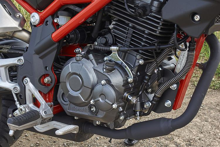 The engine on the Benelli is set in the bright red frame