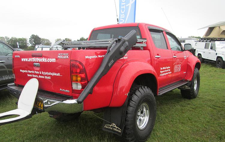 A brught red very large pickup truck used by Top Gear to drive to the North Pole