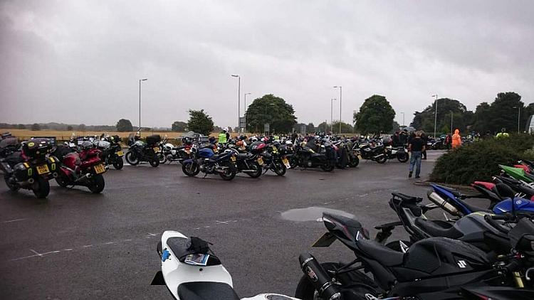The car park is wet, the skies are grey and the motorcycles look forlorn in the horrible weather
