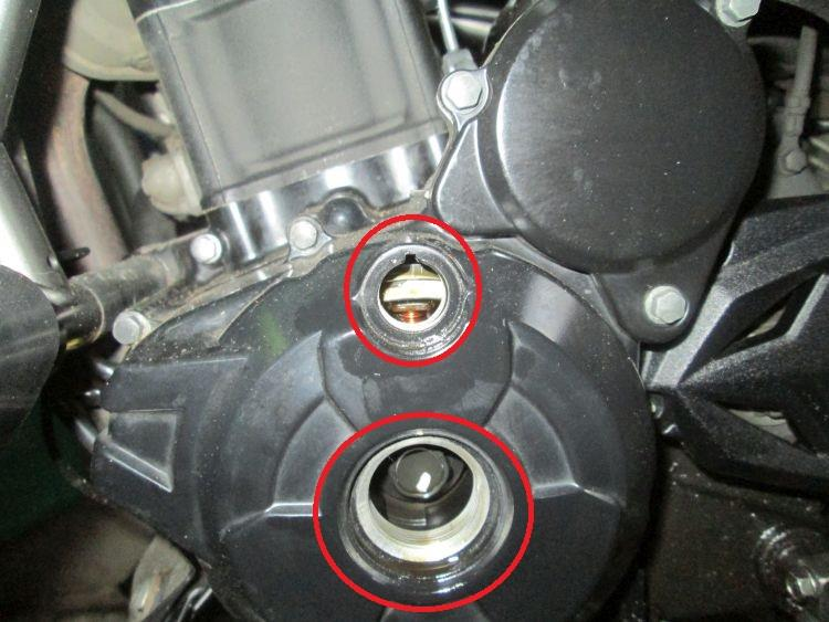 The left side of the motor with the access holes removed and circled in red