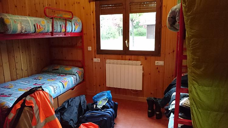 4 metal framed bunks in the second bedroom of the lodge